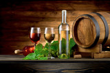 Wine bottle and glasses with wooden barrel on the table - 141880107