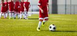 Soccer Football Training for Kids. Youth Soccer Academy Training. Boy Kicking Soccer Ball