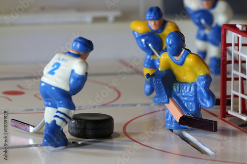 attack ice hockey.attack ice hockey match, table game macro shot. Poster