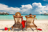 Couple in loungers on beach at Maldives - 141937511