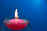 Floating candle on a bright colored background