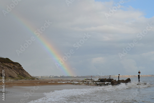 Rainbow after stome Dorset Coast Hengisbury Head UK