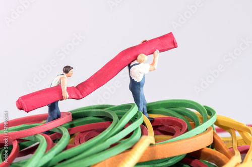 Poster Hard work - two males carrying a rolled up carpet - going to the right side - mi
