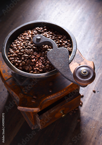 close-up of old coffee grinder and roasted coffee beans