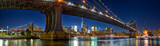 Manhattan and Brooklyn Bridge panorama with skyline at dusk, New York