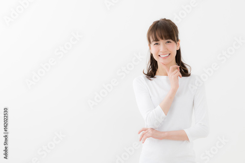 Poster portrait of young asian woman isolated on white background