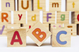 Fototapety Spelling blocks toys with ABC in the foreground