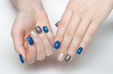 Shiny blue, blue, black, gray, silver manicure on square long nails on a white background a large scale