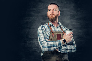Close up image of a man holds a cup of coffee.