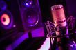 LensBaby tilt shift background, recording studio vintage microphone.