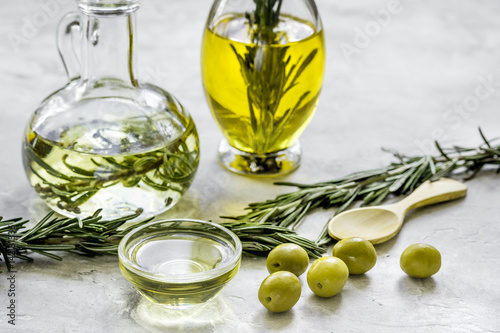 oil in carafe with spices and olive on stone background Poster