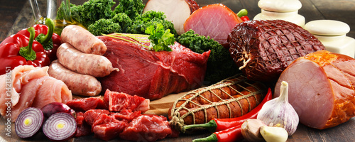 Variety of meat products including ham and sausages - 142136151