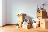 Move. Cardboard boxes and cleaning things for moving into a new home - 142136315