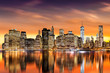 Sunset over New York City's Financial District as viewed from Brooklyn, with skyline reflections in East River