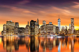 Sunset over New York City's Financial District as viewed from Brooklyn, with skyline reflections in East River - 142143132