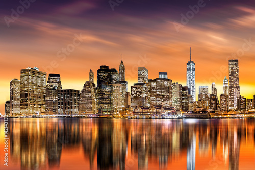 Naklejka Sunset over New York City's Financial District as viewed from Brooklyn, with skyline reflections in East River