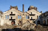Ruins of old abandoned plant with gas furnace chimney,Odessa,Ukraine.