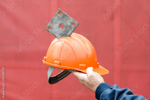 Helmet saved the life of a construction worker Poster
