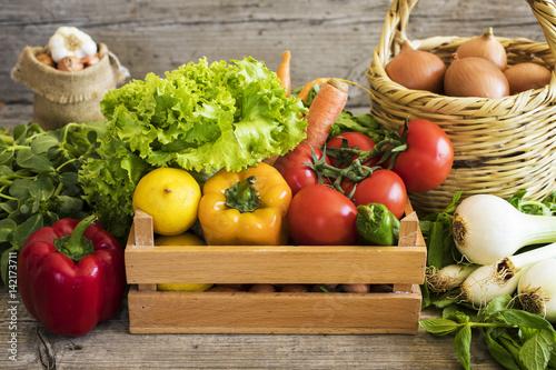 Vegetables in basket on wooden table - 142173711