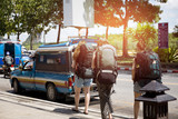 Fototapety backpacker travelers getting taxi on the street