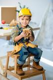Boy eating sandwich - 142195594