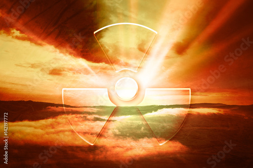 Foto op Plexiglas Bruin Dramatic red evening sky with illustrated radiation symbol. Conceptual nature landscape disaster background.