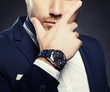 Watch and fashion suit of young man