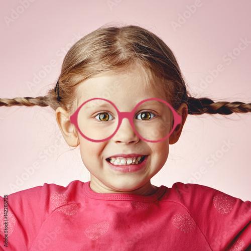 Fotografiet Curious smiling girl in drawn pink eyeglasses