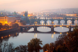 Morning view from above on Prague bridges, Charles Bridge on first plan.
