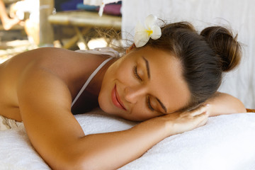 Satisfied woman after massage