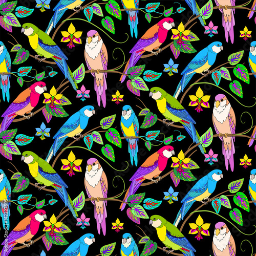 Multicolor parrots in jungle seamless tropical pattern.