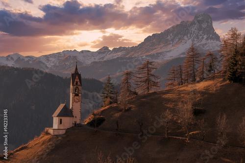 dolomites mountain church at sunset