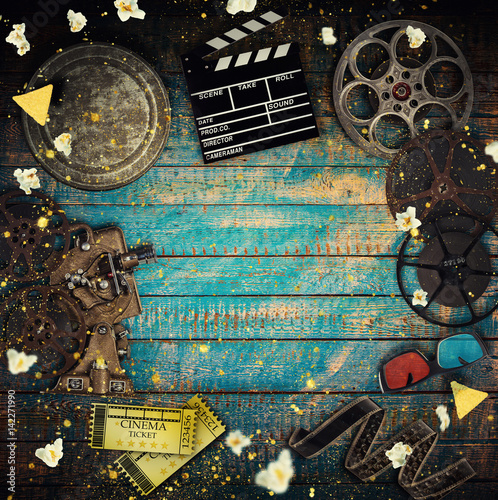 Poster Cinema concept of vintage film reels, clapperboard and projector.