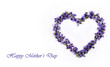 Delicate spring violets in the shape of a heart on a white background. Mother's day