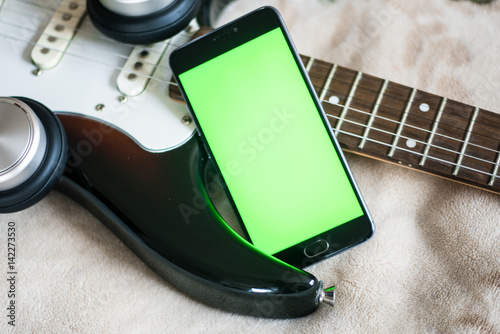 green screen on an acoustic guitar Smartphone with Poster