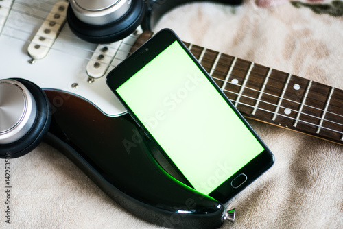 on an acoustic guitar Smartphone with green screen Poster