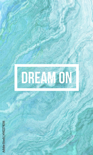 Dream on motivational quote on abstract liquid background. Photo by shekularaz