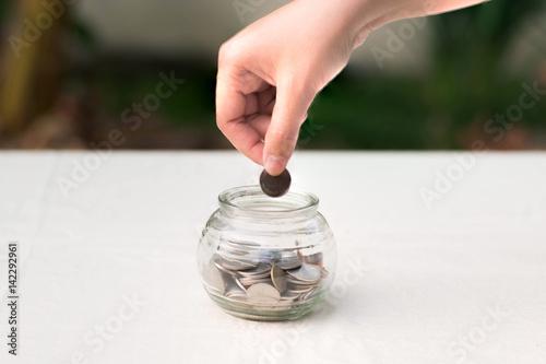 Women hand throwing coin  money concept.