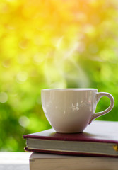 Cup of coffee on nature background.