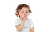 Cute baby has put forefinger to lips as sign of silence - 142320553