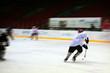 Hockey player in generic white equipment