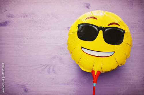 image of cute smiling emoticon wearing black sunglasses, emoji concept Poster