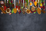 Various spices spoons on stone table. Top view . - 142377701