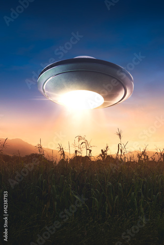 Foto op Canvas UFO with abduction beam flying in the sky
