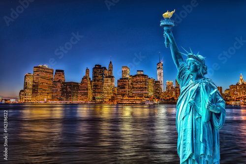 Statue of liberty with Manhattan skyline Poster