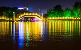Huizhou Jiuqu bridge on the artificial lake in Guilin travel area with tourists walking
