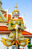 BANGKOK,THAILAND - MARCH 18,2017 Statue of Giant at Wat Arun. Wat Arun or Temple of the Dawn is one of a famous Buddhist temple in the Bangkok