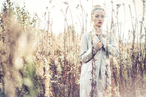 Fashion beautiful lady in autumn landscape - 142480518