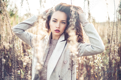 Fashion beautiful lady in autumn landscape - 142480534