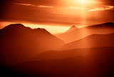 A beautiful, colorful, abstract mountain landscape with sun in a red tonality. Decorative, artistic look.